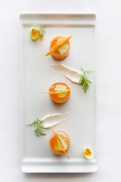 Saumon Fumé  Smoked salmon roulade filled with salmon rillette served with cucumber and dill relish, salmon caviar