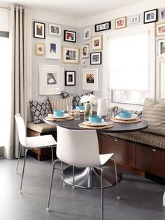 Nifty under-seat storage and a gallery wall of art make this the perfect place for lingering with a cup of coffee and the paper. Source