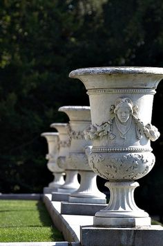 Urn sculptures in a formal garden