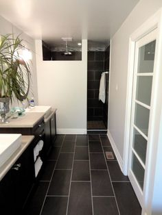 Julie Loves Home: Master Bathroom   L O V E this idea.  Timeless subway tile look combined with a strong/neutral dark grey/black that can support any color beautifully.