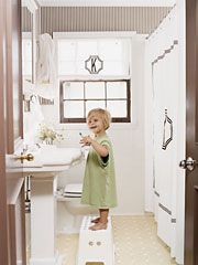 this is from one of my favorite cottage living spreads (miss that magazine!)...child's bathroom inspired by henri bendel stripes. love!