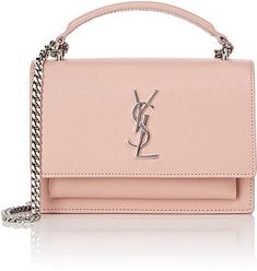 a9db9d55c61 Crafted of light pink smooth leather, Saint Laurent's Monogram Sunset chain  wallet is detailed with oxidized silvertone hardware.