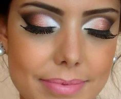 The white and different shades of brown eye shadow and a nude/light pink lipstick