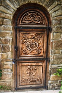 Untitled  / Zina Grishina  Beautifully carved wooden Arch door with studded Iron work in Moscow, Russia