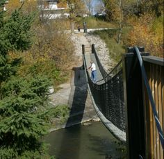 Named after a generous local businessman, the Roy Wilson Suspension Bridge crosses the Wabigoon River in Dryden. Dryden Ontario, Discover Canada, Suspension Bridge, Road Trippin, Canada Travel, To Go, Coast, River, Sunset