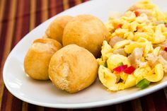 Ackee and saltfish (Jamaica) Eaten mostly with rice, it involves saltfish sauteed in boiled ackee (national fruit of Jamaica) and other vegetables like tomatoes, onions, peppers, garlic and thyme.