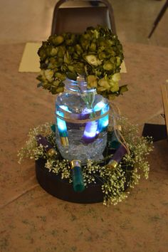 Mason jar, led lights in shotgun shells for wedding reception centerpiece