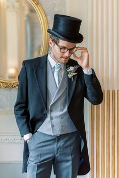 hedsor house spring summer wedding; black groom top hat; armani long coat with pale blue vest and neck tie pin stripe trousers | Photo by London and Newcastle UK based light bright and airy Filipina wedding photographer Cristina Ilao Autumn Wedding, Spring Wedding, Wedding Blog, Hedsor House, Black Top Hat, Garden Wedding Inspiration, Blue Vests, Beautiful Wedding Venues, Groom Wear