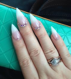 Fierce stiletto French tip manicure with Swarovski crystals by @your.perfect.ten and found on @krogansmash.