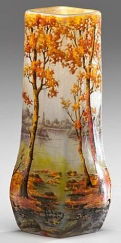 A French, early 20th century, Daum Nancy [Cameo] glass scenic vase, [depicting trees and river], original retailer's label on underside, signed near foot. Made in France, circa 1901-1925