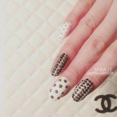 Studded out short stilleto nails.