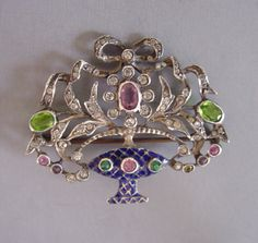 """PASTE and sterling basket brooch marked """"935"""" on the back, blue enamel with pink, green and clear pastes in a cast silver setting, 1-3/4"""".  This is a 20th century pin made in the style of Victorian """"giardinetti"""", or little garden brooches."""