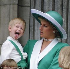Harry sticks out of his tongue while with his mother Diana...