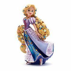 Figurine Raiponce Disney Showcase | Disney StoreFigurine Raiponce Disney Showcase - Cette figurine Raiponce Showcase Disney repr�sente la princesse aventuri�re, de fa�on tout � fait charmante. Peinte � la main, sa robe � fleurs est orn�e de strass brillants et elle porte des fleurs dans sa longue tresse dor�e.