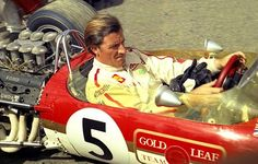 Graham Hill Lotus 49B Gold Leaf those where the cars without spoiler and first racingcar with advertising on it.