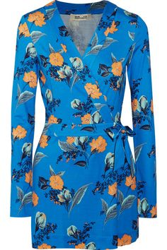 Diane von Furstenberg's 'Celeste' playsuit is cut from fluid silk-jersey printed with cerulean, mint and orange florals. It's designed in the label's signature wrap silhouette, which draws attention to your narrowest point. Balance the mini length with flat sandals.