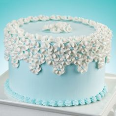 Drop flowers are always a hit! They?re easy to do and look great on your cake, especially when finished with a blue Sugar Pearl center.