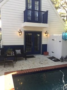A pair of French Quarter Lanterns to light this charming pool area!
