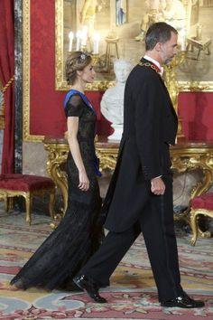 Queen Letizia in her floor-sweeping Carolina Herrera gown.
