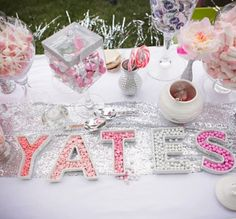 Candies in letter-shaped trays spelled the couple's name. temple wedding, wedding photography, moh idea
