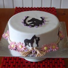 Horse silhouette cake done for a sweet girl who loves her horses.  Choc mudcake covered in fondant.  silhouettes hand cut, flowers, rope and tassles hand made and edible :-)