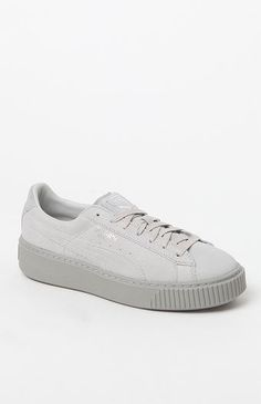 Give your casual style a boost with the Women's Gray Platform Reset Sneakers made by Puma. A well-loved classic, these platform sneakers are defined by a suede upper with a basket side, a thick rubber sole, wordmarks, and a lightly cushioned footbed for extra support. Suede upper Basket side Textile lining Lightly cushioned footbed Puma branding on tongue tag, side and heel Thick rubber outsole