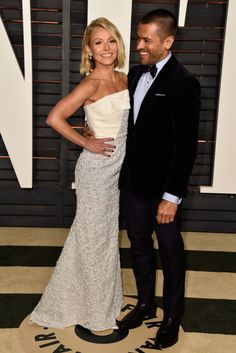 Kelly Ripa and Mark Consuelos. See what all the stars wore to the Academy Awards' biggest after party.