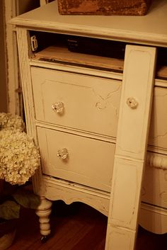 Great idea for a converting a vintage dresser into a media center to hide television, DVD player and all that other ugly stuff!