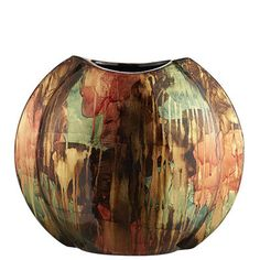 Created by hand and finished with hand-applied gold leaf, our shimmering ceramic vase has a one-of-a-kind look typically found in galleries. But it's made for your home, where you can feel free to set your own exhibit hours.
