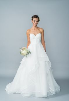 Your Dream Bridal // Lis Simon - Lace/Satin-Organza Strapless sweetheart neckline, lace appliqué bodice with decorative boning, tired satin organza skirt with ribbon and lace appliqué, fabric buttons and zipper back. http://www.yourdreambridal.com