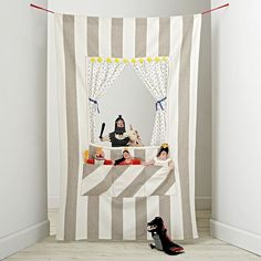 Create a puppet show anywhere in your home with the help of our Off Broadway Puppet Theater. It's easy to set up and has plenty of pockets to hold hand puppets. This versatile doorway puppet theater features tie-back curtains and a decorative star garland.