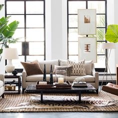 uses presido chair and presidio couch with a modern leather chair in corner