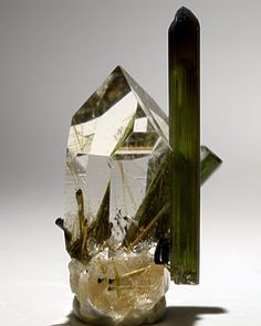 Quartz and Elbaite | #Geology #GeologyPage #Mineral Locality: Golconda Mine Gov. Valadares Minas Gerais Brazil Size: Elbaite is 0.75 inches tall and the Quartz crystal is 0.7 inches tall. Photo Copyright Stan Celestian/flickr Geology Page www.geologypage.com