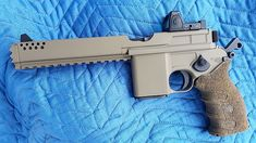 """Modernized Mauser Formerly known as the broomhandle. "" Wh-why does it have a serrated muzzle are you going to breach doors with it. Sci Fi Weapons, Concept Weapons, Weapons Guns, Guns And Ammo, Luger Pistol, Survival Rifle, Hand Cannon, Custom Guns, Military Guns"