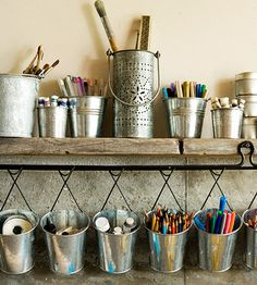 Vintage Finds:  Recycle a plank into as a shelf that can hold vintage tins for brushes and paints. Attach a wire hanger beneath the plank to hold galvanized buckets filled with smaller supplies.