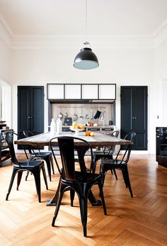A herringbone floor makes anything look more dramatic... but dark furniture and accent colors definitely helps.
