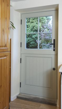 French Grey stable door looks perfectly at home in this lovely rural cottage. Cottage Front Doors, Cottage Windows, House Front Door, House Doors, Timber Windows, Windows And Doors, Wooden Back Doors, Cottage Exterior, Cottage Doors Interior