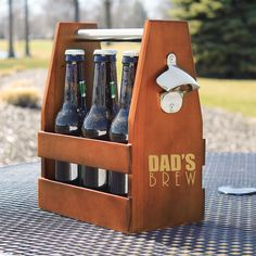 Give Dad a hand carrying his favorite brews with the Dad's Brew Wooden Craft Beer Carrier with Opener. Stained in the color of a rich amber ale, the custom engraved container comes complete with attached stainless steel bottle opener and beveled edges.