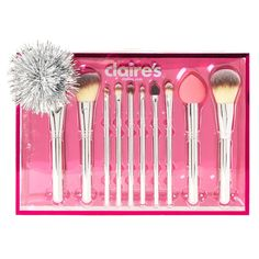 Chrome Silver 10 Piece Makeup Brush Set | This set of makeup brushes comes in a pretty holiday themed packaging topped with a shiny red bow! Featuring 10 of Claire's must have makeup brushes for all your makeup needs