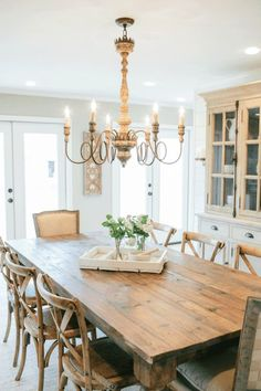 Gathering around a large farmhouse table can do the trick to add some old world charm. It doesn't matter what style your kitchen his, a large wooden table fits in every decor.