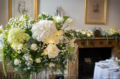 A Wilde Bunch tall vase design at North Cadbury Court using 'classic' wedding whites with a touch of illumination to add depth and warmer tones within the design. Country House Wedding Venues, London Bride, Tall Vases, Bridal Hair Accessories, Wedding Events, Wedding Flowers, Floral Design, Floral Wreath, Touch