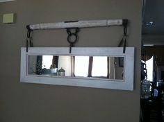 Mirror hanging from an old yoke or piece of a wagon (not sure), but a buyer really liked it