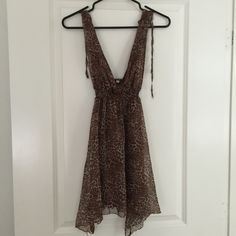 SALE❗️⬇️ RARE Brandy Melville Leopard Dress New without tags. A very rare deep cut neck leopard print dress with elastic waist band. 100% polyester. Purchased in Italy but never worn! Size S.  trades Brandy Melville Dresses Mini