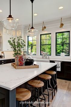 Vintage-inspired pendant lights hang above an expansive island in this Modern Farmhouse kitchen. Vintage-inspired pendant lights hang above an expansive island in this Modern Farmhouse kitchen. Farmhouse Kitchen Lighting, Modern Farmhouse Kitchens, Home Decor Kitchen, Rustic Kitchen, New Kitchen, Home Kitchens, Kitchen Ideas, Kitchen Modern, Modern Pendant Lighting Kitchen