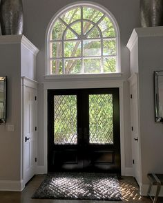 Dark stained front door. The homeowner have replaced the old front door and side…