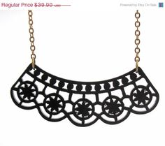 """Black Lace Necklace - Minimalist Jewelry - Art Jewelry - Gift For Her   Stunning laser-cut statement necklace made from black acrylic,  It comes on a gold plated cable chain.   The necklace total measure approx: 18"""" (45cm)(with the pendant).  Pendant measures approx 1.7"""" (4.5cm) in width.  All of my jewelry comes with a gift box.   $39.9"""