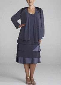 stunning chiffon jacket dress!  Sleeveless bodice features dazzlingand eye-catching beaded neckline.  Multi-tiered skirt adds dimension and flare to this already sensational number.  3/4 sleeve chiffon jacket with sparkling beaded shoulder detail provides just the right amount of coverage.  Fully lined. Side zip.