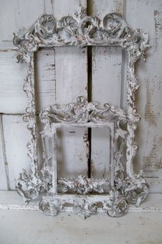 White ornate wall frames accented in gray pewter and deep gold French farmhouse wall decor Anita Spero on Wanelo