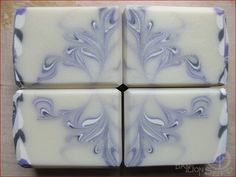 Beautiful and feminine purple soap design using cold process and a hanger swirl