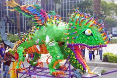 Arts: In Mexico there is the Parade of Alebrijes. Alebrijes are kooky animals. They are made up of different animals parts with there being one main animal that these parts are added to like this crazy chameleon. This celebration is done a few days before Dia de Los Muertos. These parades happen in different parts of Mexico. Alebrijes in the parade are gigantic, carved from wood and controlled from inside. Vendors set up shop and sell mini alebrijes. This year it was on October 23.